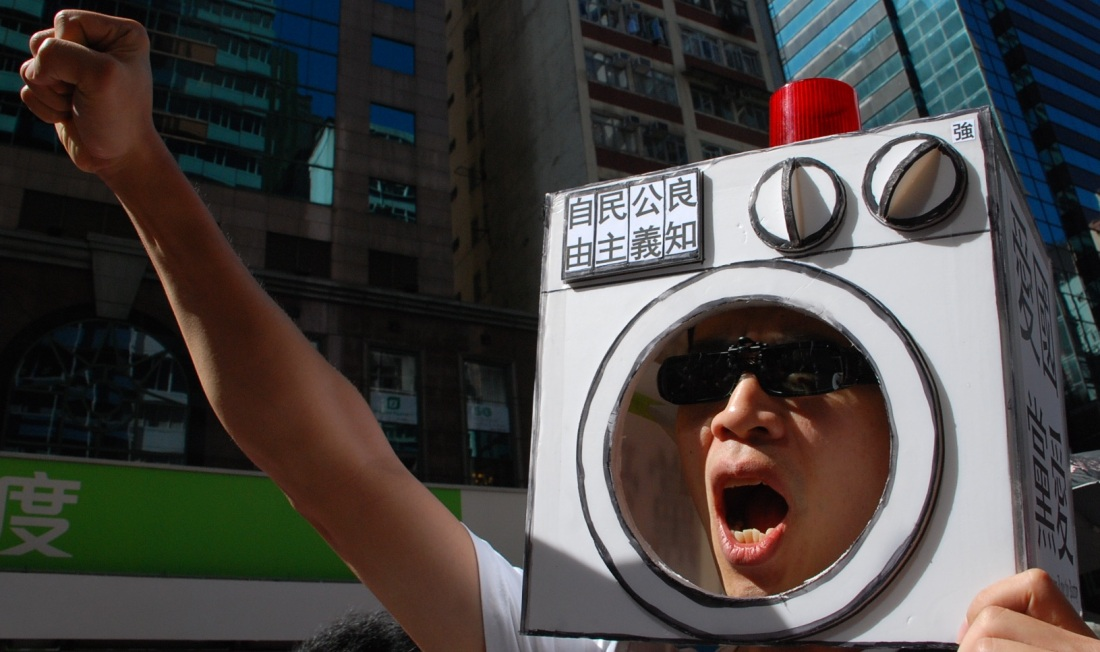 Protester depicted with head in washing machine